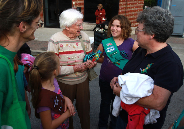 9-28-12<br /> Oktoberfest<br /> Florida resident Lenore Costello talks to Girl Scouts after receiving gifts from them at Oktoberfest. Costello is the oldest Girl Scout in Florida. She is 95 years old.<br /> KT photo | Kelly Lafferty