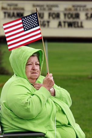 """Shirley Nelson of Bennett Switch holds an American flag as she waits outside of Taylor High School for the procession to begin. Nelson's granddaughter was friends with Sgt. Atwell. """"I just felt like I needed to be here,"""" said Nelson.<br /> KT photo 