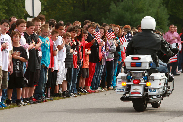 Taylor students and faculty, along with members of the community line the streets to show their respect for Sgt. Atwell as the motorcade makes its way in front of Taylor High School on Friday.<br /> KT photo   Kelly Lafferty