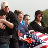 Josh Hale hugs MaryAnne Budenz-Dishon after Sgt. Atwell's procession that went past Taylor High School on Friday. Budenz-Dishon had Sgt. Atwell when he was in class at Taylor High School and Hale was one of Sgt. Atwell's very good friends and fellow classmate. <br /> KT photo | Kelly Lafferty