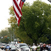 9-28-12 <br /> Sgt. Bradley Atwell's remains are flown into Grissom AFB and brought to Chapel Hill Christian Church with a procession about 2 miles long including about 250 motorcycles from the Patriot Guard on Friday morning. The procession approaching the church on Alto Road at Water Street where Harrison Twp VFD flew a flag over the road.<br /> KT photo | Tim Bath
