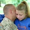 7-17-14<br /> Surprise soldier return<br /> Tears roll down 13-year-old Maiah Lee's face as she hugs her dad David Lee. Lee and his brother Jake surprised their kids at Highland Park after being gone for a year while they served in Afghanistan.<br /> Kelly Lafferty | Kokomo Tribune