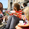 6-5-14   --- Logan Eads, 1, Claudia Eads and Addy Eads, 5, sitting on the courthouse steps at Strawberry Festival downtown. --<br />   Tim Bath | Kokomo Tribune