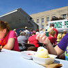 6-5-14   --- Jo Trine, 10 and sister Kaylin Trine, 15, enjoying their strawberry shortcake at the Strawberry Festival downtown. --<br />   Tim Bath | Kokomo Tribune