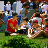 6-5-14   --- Monica Taskey and her kids David, 4, Lili, 7 and Mariana, 10, sitting on the lawn of the courthouse during the Strawberry Festival downtown. --<br />   Tim Bath | Kokomo Tribune