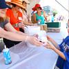 6-5-14   --- Christina Bainbridge hands a strawberry shortcake to AJ Finney, 6, who was downtown with his family at the Strawberry Festival. --<br />   Tim Bath | Kokomo Tribune
