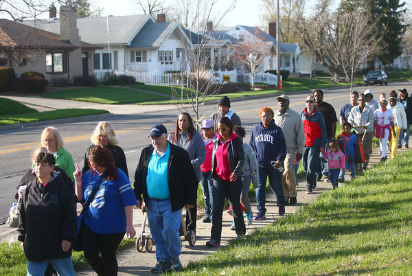 4-22-14<br /> Take Back the Night/Angel Walk<br /> Angel Walk participants walk toward IUK on Washington Street during Take Back the Night.<br /> Kelly Lafferty | Kokomo Tribune
