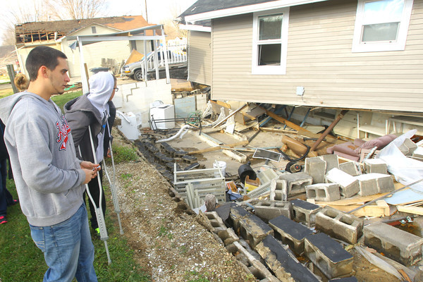 The home of Drew Larrick and housemate Taylor Glenna(l-r). They were in the basement under a mattress when the tornado lifted their house off the foundation.<br />   KT photo | Tim Bath