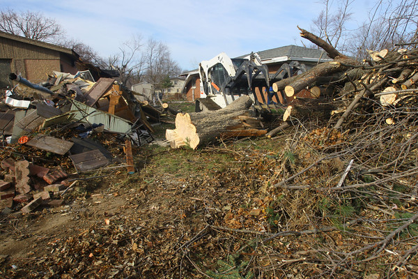 Tornado that hit Cedar Crest subdivision left a path of destruction that voluteers helped to remove. Buick Lane is cleared on Wednesday of some debris.<br />   KT photo   Tim Bath