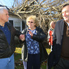 Gov Mike Pence comforts Patsy Addison as the governor tours the damaged areas. Behind her you can see the tree that has crashed through the roof of her and her husbands house. US Sen. Joe Donnelly is also with the governor.<br />   KT photo | Tim Bath