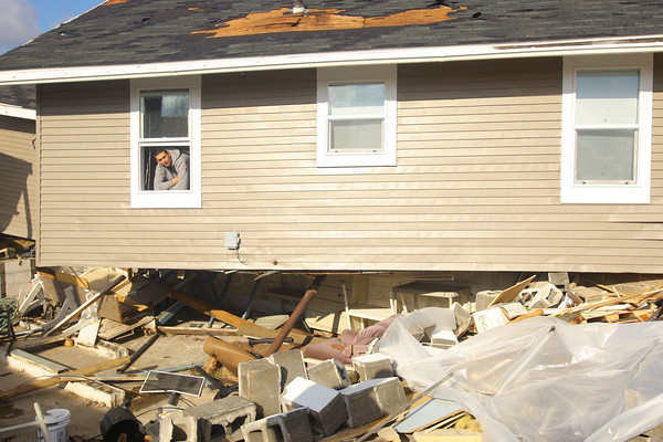 The home of Drew Larrick and housemate Taylor Glenna. They were in the basement under a mattress when the tornado lifted their house off the foundation. Drew yell out to family and friends to help him move items out of the house.<br />   KT photo | Tim Bath
