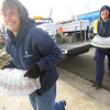 Pam Fivecoate from Indiana American water and KPD officer Jim Gunlite bring water to a food site in the Cedar Crest area that was ravaged by the tornado.<br />   KT photo | Tim Bath