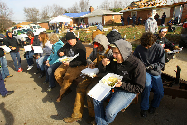 Tornado that hit Cedar Crest subdivision left a path of destruction that voluteers helped to remove. United Way and St. Joseph Hospital set up food stations to feed anyone in the area. They had another set up near Ricketts and Bell.<br />   KT photo   Tim Bath