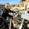 Marci May looks through the rubble of her business on East Lincoln Road for any salvageable items. She had a party going on during the tornado with 10 little girls that all piled in the bathroom just before the walls came down.<br />   KT photo | Tim Bath