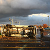 A van sits on its side near a fallen light near JC Penney.<br /> KT photo | Kelly Lafferty