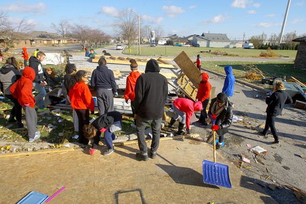 Kokomo High School kids help clean up areas on Hoffer Street including this UAW 685 storage barn and its contents that were destroyed.<br />   KT photo | Tim Bath
