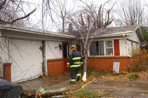 KFD firefighter Ray Fitzgerald goes door to door checking on residents in the Cedar Crest subdivision where the tornado hit the hardest.<br />   KT photo | Tim Bath