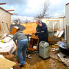 Stacy Broniak, granddaughter of the owner, and Todd Woolf, a Grissom Firefighter who lives in the neighborhood sift through debris looking for medication and oxygen supplies. Stacy's grandmother Colleen Carney lived in the house.<br />   KT photo | Tim Bath