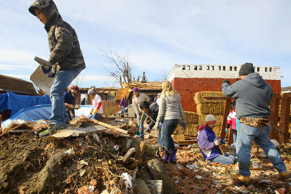 Tornado that hit Cedar Crest subdivision left a path of destruction that voluteers helped to remove. Pontiac Drive is cleared on Wednesday of some debris.<br />   KT photo | Tim Bath