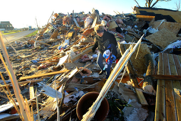 Phyllis Rawlins goes through items in her house that was destroyed on Ricketts.<br />   KT photo   Tim Bath