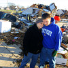 Phyllis Rawlins goes through items in her house that was destroyed on Ricketts. Her grandson, Hayden Rawlins, showed up to help and gave her a hug.<br />   KT photo   Tim Bath