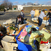 Kokomo High School kids help clean up areas on Hoffer Street including this UAW 685 storage barn and contents that was destroyed.<br />   KT photo | Tim Bath