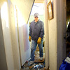 David Lytle walks out of his mother-in-law's bedroom while searching for salvage items. Freda G. smith, the owner was huddled in this hallway just outside of this room.<br />   KT photo | Tim Bath