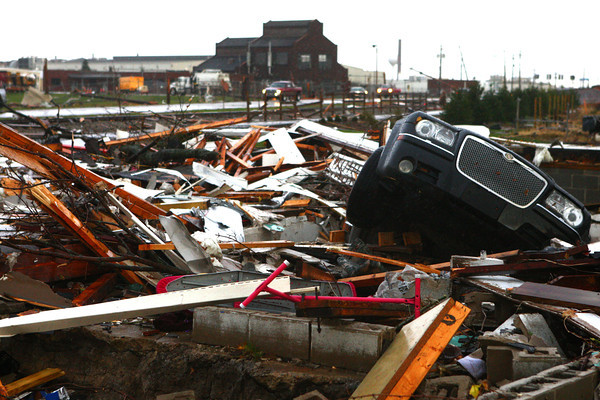 A car sits in the basement of a Home Avenue and Hoffer Street home that leveled by severe weather on Sunday.<br /> KT photo | Kelly Lafferty