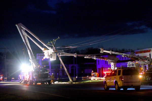 The tornado took down power lines all over Kokomo with workers replacing lines along South Webster on Monday evening.<br />   KT photo | Tim Bath