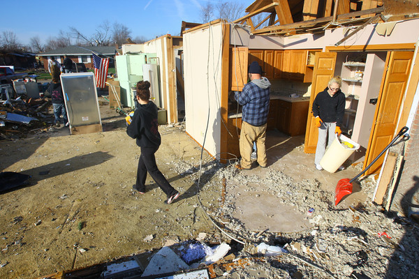 Tornado that hit Cedar Crest subdivision left a path of destruction that voluteers Tiffany Corbit and Kirsten Wade helped to remove. Pontiac Drive is cleared on Tuesday of some debris.<br />   KT photo | Tim Bath