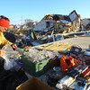 Phyllis Rawlins goes through items in her house that was destroyed on Ricketts. Ben Eikenberry was helping to box things up that were salvageable.<br />   KT photo | Tim Bath