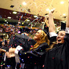 6-6-14<br /> Western Graduation<br /> Meghan Johnston (right) throws confetti in the air as she celebrates with the rest of Western High School's Class of 2014 after the graduation ceremony.<br /> Kelly Lafferty | Kokomo Tribune
