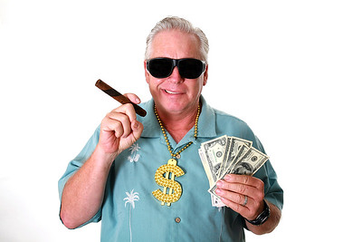 A man with money. A man wins money. A man has Money. A man Sniffs Money. A man Loves Money. A man an
