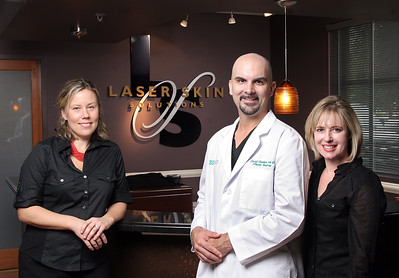 111109 - Laser Skin Solutions advertisment for The Palm Beach Post. (L to R) Kathryn Walton, Account Executive; The Palm Beach Post, David Rankin, MD Plastic Surgeon; Laser Skin Solutions, and  Karen Lederman Business Partner Laser Skin Solutions.  Photo by Tim Stepien