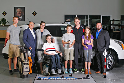 Cover Photo- From left: President/CEO of Ed Morse Automotive Group Ted Morse, Thomas, Brayden, and Director of Advertising and Marketing of Ed Morse Automotive Group, Teddy Morse. Additional names to be sent by Stephanie Glavin. (Photo by Tim Stepien)