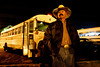 March 15, 2007_Calexico, CA_JOSE MORENO, foreman for El Don Farm Labor Contracting,Inc., stands in front of a white bus he will drive; one of many that  line a parking lot in Calexico, California at 4:30 a.m., on the United States side of the US/Mexico border crossing from Mexicali, Baja California. Labor contractors wait for the workers, who fill their buses in search of day-work in the fields of Imperial Valley and Yuma, Arizona._Mandatory Credit photo by Laura Embry/San Diego Union-Tribune/Zuma Press, copyright 2007 San Diego Union-Tribune