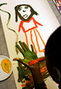 LE_statom252270x001_2-15-2006_Escondido, CA._San Pasqual Academy student La Shanae Summers, 15, paints her hand to add a handprint to her self-portrait, depicting how she might appear 15 years in the future, during an art class session with Therman Statom, an internationally recognized glass artist._LAURA EMBRY/ San Diego-Union-Tribune