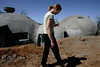 April 19, 2006, Julian, CA_ USA_SUSAN McDERMID,  walks past the upper part of her dome home in Cuyamaca Woods, near Julian, where her family is still living in a trailer one year after her family started construction on their new house to replace the one they lost in the Cedar Fire. _Mandatory Credit photo by Laura Embry/San Diego Union-Tribune/Zuma Press, copyright 2006 San Diego Union-Tribune