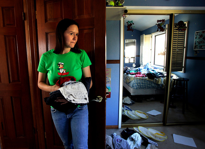 Mission Bound--Lindsay Buckner, 18, of Cardiff, California, gives a last look around her room as she decides on what to pack for her two-year mission trip that will take her to various parts of the world.