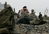 A vacationing Sonia Love of Gourock, Scotland, photographs rocks stacked on rocks at Cardiff Rocks improbably stacked on other rocks form beautiful sculptures at Cardiff State Beach, just south of Restaurant Row in Encinitas.--Laura Embry/Union-Tribune