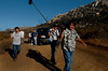 "September 15, 2004_Barona, California_Lori, Melanie, Lindi and Lonnie Bellante talk to Troy Hartman, host of a show tentatively called, Extreme Survival"" for the Discovery Channel, as producer Bob Wise, left, sound man Steve Schwaer, center, and camera man Paul Desatoff, walk ahead on a dirt road in Wildcat Canyon to prepare for filming the family's story of the night they escaped the Cedar fire._Mandatory Credit photo by Laura Embry/San Diego Union-Tribune/Zuma Press, copyright 2006 San Diego Union-Tribune"