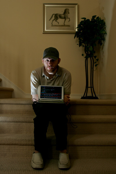 Lance James, founder of Secure Science Corp, sits with his laptop on the steps to his home office in San Marcos. He is an expert on an Internet scam called phishing that cons people by sending out phony e-mails warning their account is compromised and getting them to provide confidential info about themselves.--Laura Embry/Union-Tribune