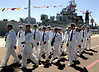 September 18, 2006_San Diego, CA_People's Liberation Army (Chinese Navy) sailors head to a tour bus from Pier 2 at  San Diego Naval Base at 32nd Street, after arriving on Qingdao, a destroyer, along with Hongzehu, a support ship, at the navy base, Monday morning. The group was headed to the San Diego Zoo, where they disembarked and to view the Midway and the Star of India, from their buses. This makes only the third visit by Chinese Navy ships to a mainland U.S. port (the second to San Diego; the other was in 1997). The ships will make a 2-day port call, and participate in a search-and-rescue exercise with U.S. Navy units off the coast. _Mandatory Credit photo by Laura Embry/San Diego Union-Tribune/Zuma Press, copyright 2006 San Diego Union-Tribune