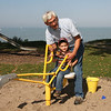 Kaydon Croft, on The Digger, gets help from Grandfather Gus Lipovsky, visiting here for another wedding in Linwood-----three weddings on Sunday by the beach.