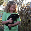 Bronwyn holding Bob, one of the rabbits at Apple Hill Farm in Vermilion Township.