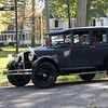 Ron and Barb Geil treasuring their newly purchased 1926 Hupmobile with former owner Sally Cox in the backseat, all from Vermilion.