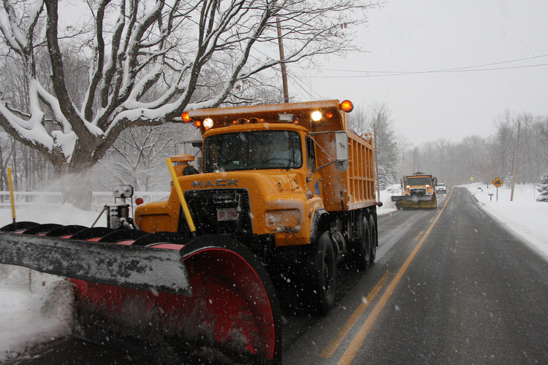 On North Ridge Road, going East, two snow plows.