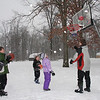 # 7125, The Hoerig kids playing basketball on their driveway on North Ridge Road on Saturday. Being outside they said, is more fun ! Green jacket Luke. Black- Bryce, Puple, Chloe and Grey and Red, Ian. Parents are Julie and Chuck.