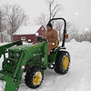 Dave Powell, using his Front Loader to get access to his weekend home on Vermilion Road.