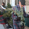 City employees, Jerry Showalder and Dana Corigin are removing the greenery by the City building.